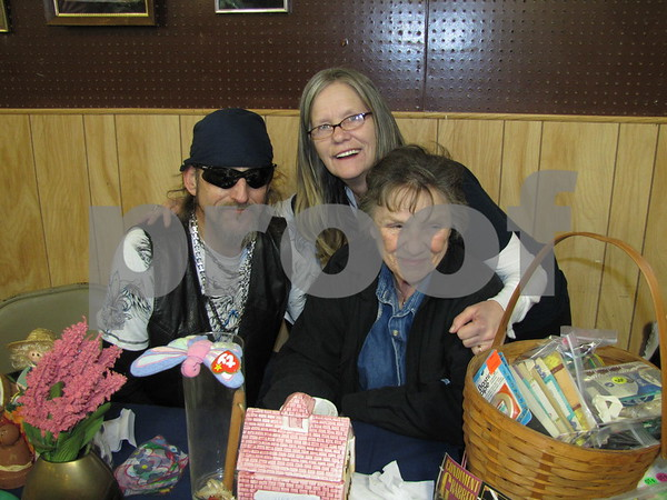 Bob (Hollywood) Hathaway and Crystal Parish with their mom Jackie Peterson in Peterson's booth at the flea market.