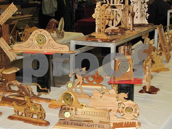 Intricate wood cutouts and clocks.