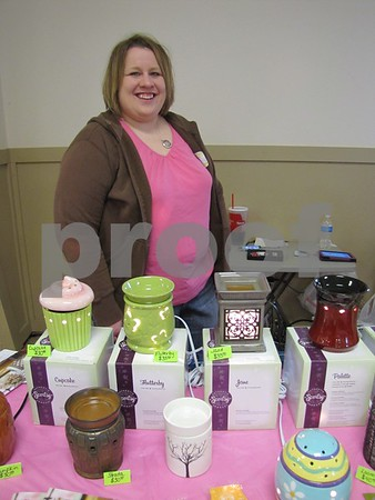 Holly Umsted with Scentsy merchandise.