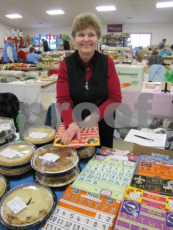 Janet Fetters with her fresh baked pies at the Winter Flea Market.  She also has cookies and bars, and needlework projects.