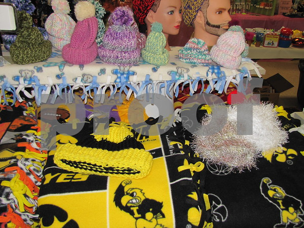 Many hand knit one-of-a-kind items were for sale at the Winter Flea Market at the Webster County Fairgrounds.