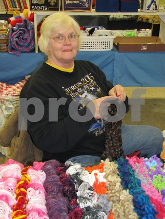 Connie Metzler working on one of her curly scarves.