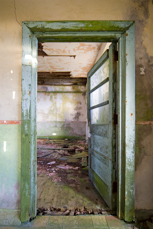A doorway inside an abandoned one-room schoolhouse in rural Ireland.