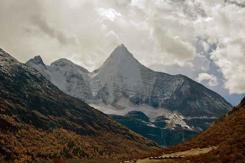 Mt. Jampelyang  (Wisdom), or 央迈勇 Yangmaiyong; Yading