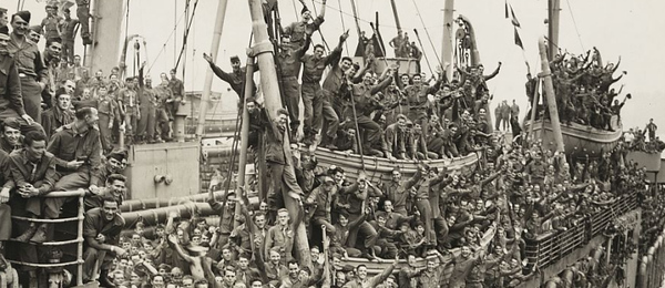 American soldiers on a Navy vessel cheering upon their return home, circa World War 2