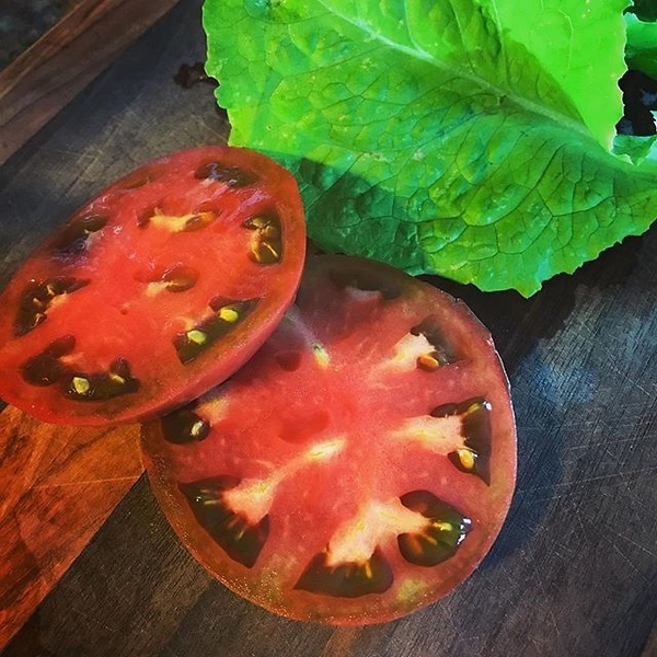 Home grown #vegetables on a self-made cutting board. Makes eating fun. Question is, what do you do with left over vegetables? #nextproject hint. #tomatoes #lettuce