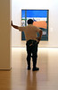 I hope he doesn't move <br /> Cantor Museum, Stanford University, CA. I entered this gallery from the back and after taking some photos, I noticed this man leaning against the wall, looking bored. He looked like a maintenance man, and I thought he was waiting for people to leave so he could get to work to fix something. I took a few photos, and was surprised he didn't move when he heard my shutter go off. As I got closer, passed him, and then looked back, I realized he was an art installation!