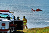Coast Guard helicopter and rescue workers <br /> I was told that a car had either fallen or more likely pushed over the edge of the cliff. No one was in the car.
