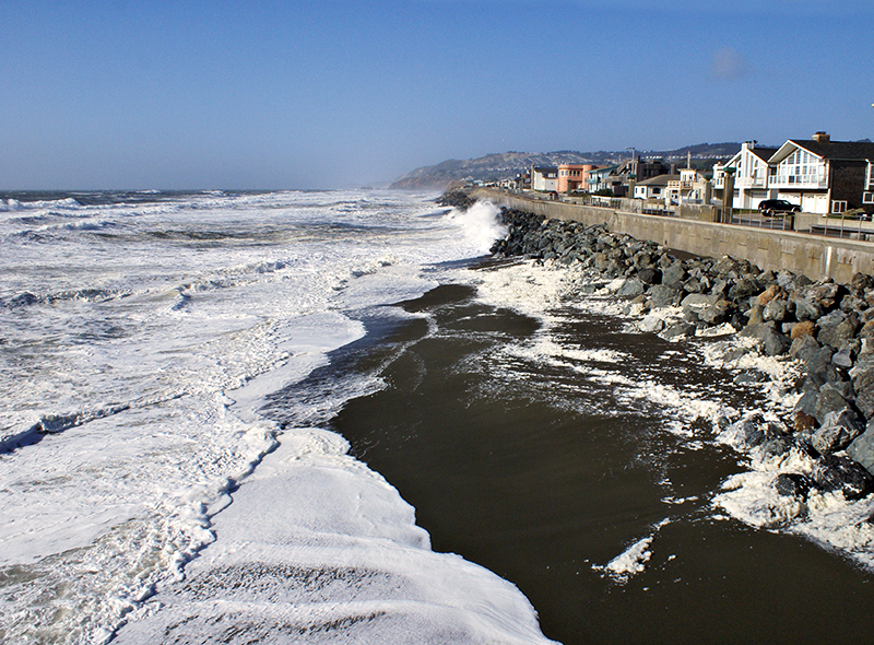 Pacifica from the Pier <br /> An extremely windy day produced lots of foam and white airy waves. BTW, I was hit on the face by a piece of flying foam, and it hurt! There's sand aerated in that foam!  :-)