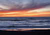 Afterglow from the sunset <br /> Pacifica's Rockaway Beach sky is a rich coral glow in the sky and beautiful reflections on the wet sand. Handheld, f6.3, 1/30 sec, ISO 400.