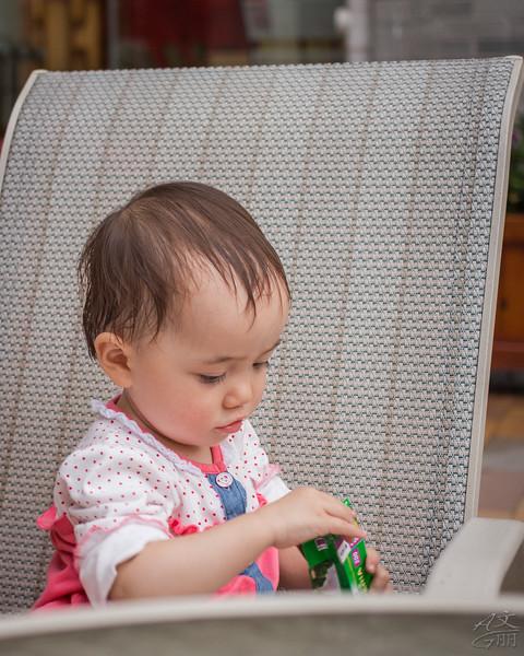 Baby looking at my Fuji 35mm film box (2013-09-09_2602)