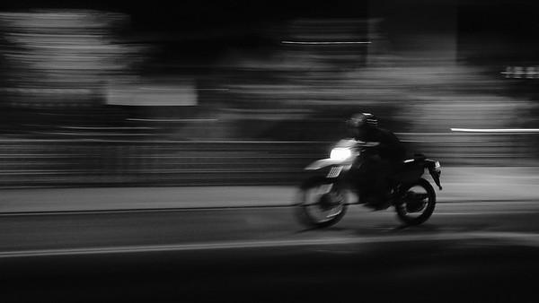 Speeding Motorcycle at Night