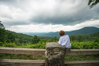 Ben Overlooking the Mountains