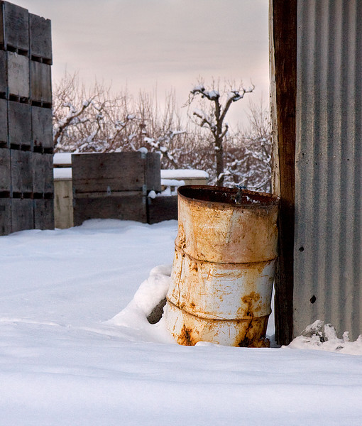 Old barrel in snow