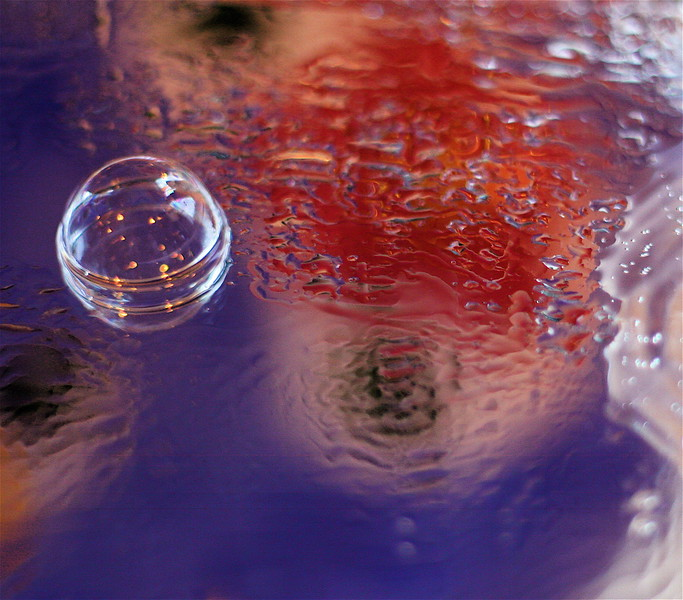 SOAP BUBBLE ON BLUE