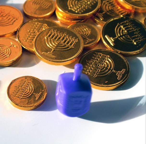 Spinning Dreidel with Gelt (chocolate coins)