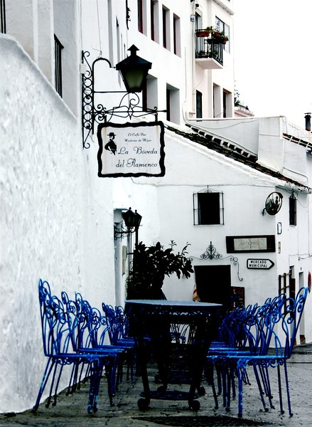 Blue Chairs in a White town