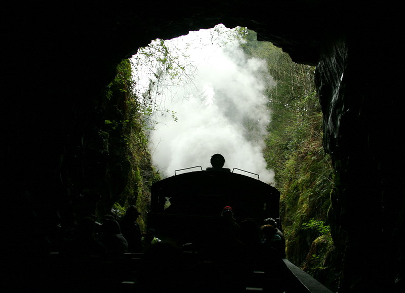 Steam train coming through the tunnel