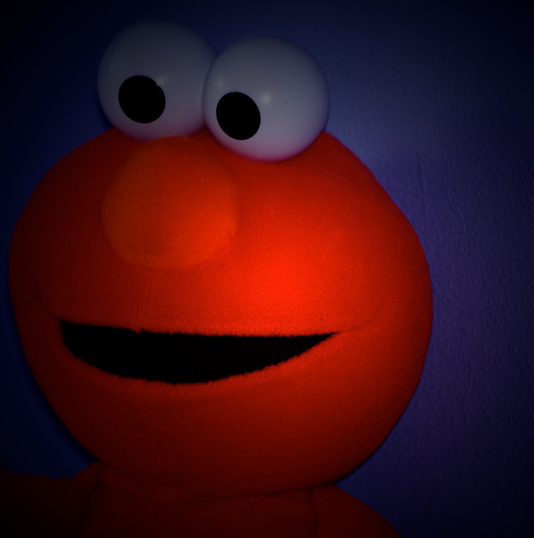 elmo caught by suprise when spotted with  a flashlight