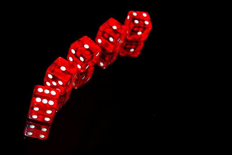 red dice on black