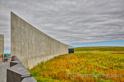 The Visitor's Center imposing wall, the black windows where visitors can look out to the crash site
