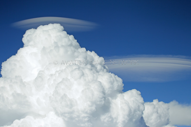 Pileus Clouds forming over rapidly building Cumulus | Taken from 28,000 feet
