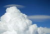 Pileus Clouds forming over rapidly building Cumulus   Taken from 28,000 feet
