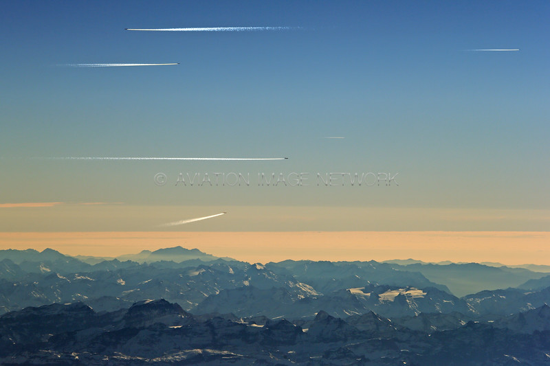 Busy Swiss Airspace above The Alps at sunset
