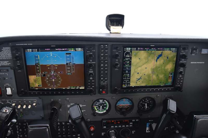 "Fancy Garmin G1000 ""glass"" panel.  The autopilot (rectangular box between the yokes) did a really good job of following the purple line of the GPS.  Who needs a Google car?"