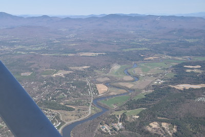 Winooksi River, Bolton Ski Resort in the distance, at the left edge is Mount Mansfield, at 4395 feet the highest point in NH