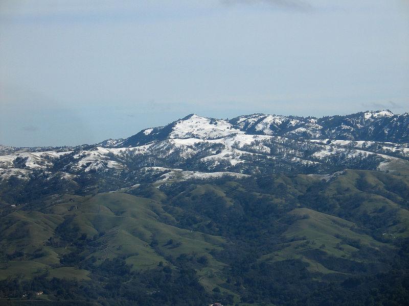 Snow on hills around Milpitas and San Jose