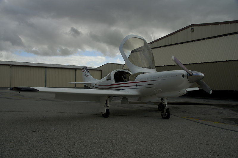 "2000 Lancair LNC2, Model 320, Experimental.  1850# gross wt  1216# empty wt  42 gal usable  +4/-1.5g (est.)  Mk-I tail, normal landing gear, no header tank, 3"" extension on motor mount  Engine: Lycoming O3601A1 then injected by LyCon in Visalia with tuned injectors (like GAMI)  Propeller: Hartzell 2-blade, 72""  Holds FAI & AFI World Speed Record from San Francisco to Los Angeles, 247 mph, 1 hour, 21 minutes in its weight class . 140K approach flaps (~10 degrees) 120K max gear speed, up/down 105K pattern w/gear down (downwind & base) 100K Vfe, max flap extended speed 85K on final w/ full flaps 140K Cruise climb,  1000fpm, full gross 105KVx,  1500  fpm 85K Vy,  1800 - 2000 fpm ~65K Vso"