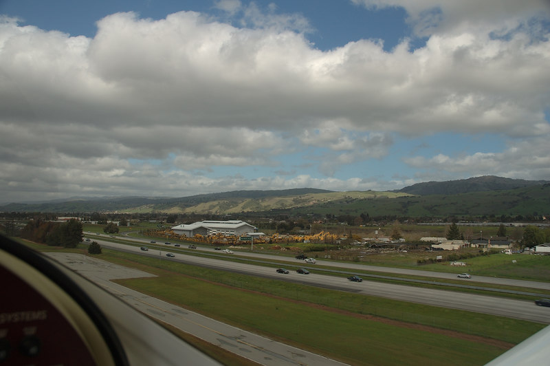 Taking off from Runway 32, with 101 Freeway alongside.