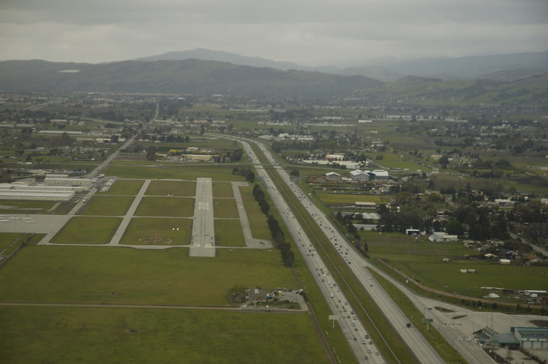 On Final approach to Runway 32 at South County Airport, and 101 Freeway to its right.