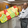 Hemendra Shah, Chief Executive Officer shows off a product created using the flock they manufacture at Spectro Coating Corp. in Leominster. SENTINEL & ENTERPRISE / Ashley Green