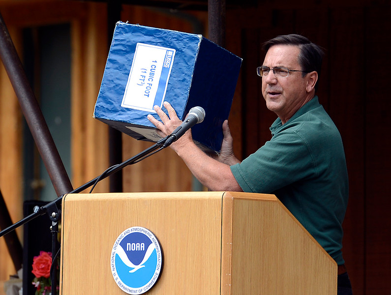 Bob Kimbrough, hydrologist and Associate Director for the U.S. Geological Survey, holds a box that represents 1 cubic foot as he describes Friday, July 29, 2016, how 31,200 cubic feet of water per second was raging down the Big Thompson River during the 1976 flood. Kimbrough and other weather and public safety experts discussed flood safety in Colorado, described improvements in weather forecasting and compared the two major flood events of 1976 and 2013 during a presentation at Sylvan Dale Guest Ranch west of Loveland.  (Photo by Jenny Sparks/Loveland Reporter-Herald)