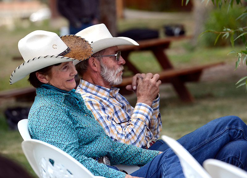 Susan Jessup, left, co-owner of Sylvan Dale Guest Ranch, and her husband, Dave Armstrong, listen Friday, July 29, 2016, as weather and public safety experts discuss flood safety in Colorado, describe improvements in weather forecasting and compare the two major flood events of 1976 and 2013.  (Photo by Jenny Sparks/Loveland Reporter-Herald)