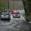 051506 : Flood scene at Brown Street in Tewksbury. Car stuck in road due to water. Photo by Tory Germann