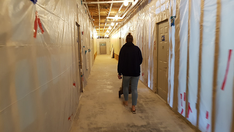 Scenes at Building 1 of The Commons in Billerica, which flooded in March temporarily displacing many residents and damaging the building. Resident who is moving out wheels a hand truck down an unfinished hallway on the first floor.  (SUN/Julia Malakie)