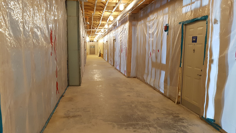 Unfinished first floor hallway in Building 1 of The Commons in Billerica, which flooded in March temporarily displacing many residents and damaging the building.  (SUN/Julia Malakie)
