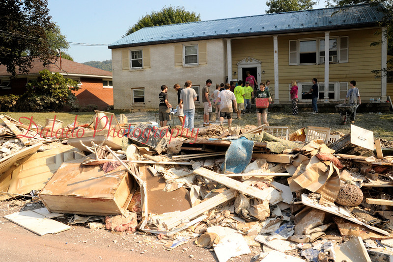 Friends and family of Joel Vought, 290 W. 11th St., Bloomsburg, near debris piled onto a sidewalk from Vought's house.