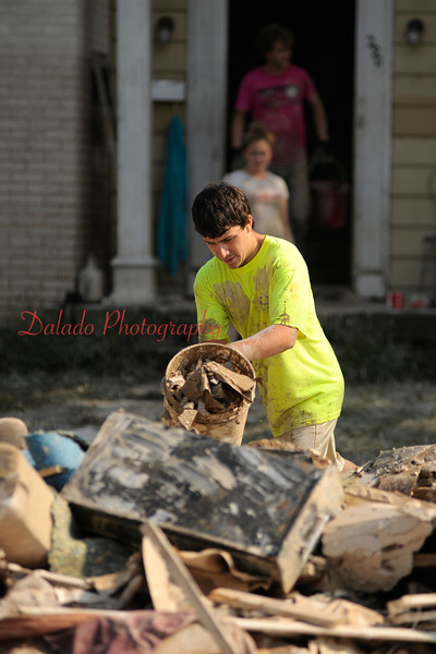 Friends and family of Joel Vought, 290 W. 11th St., Bloomsburg, pile debris onto a sidewalk from Vought's house.