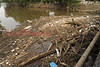 Debris on Fishing Creek is stacked against a bridge leading to Fernville at Bloomsburg.
