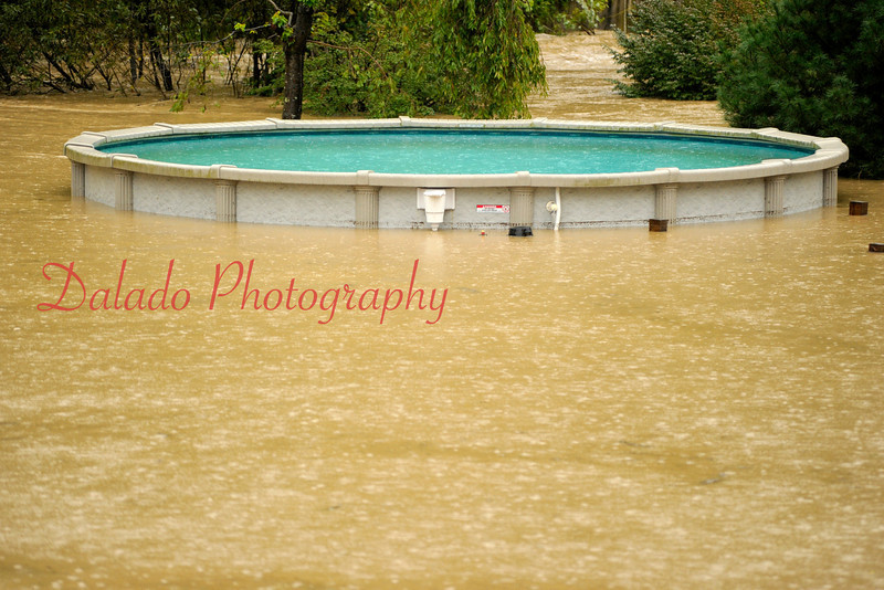 A swimming pool between Stonington and Snydertown is surrounded by flood waters on Wednesday, Sept. 07.