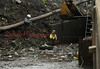 A PennDOT crew removes debris from underneath a bridge in Weigh Scales on Sept. 15.