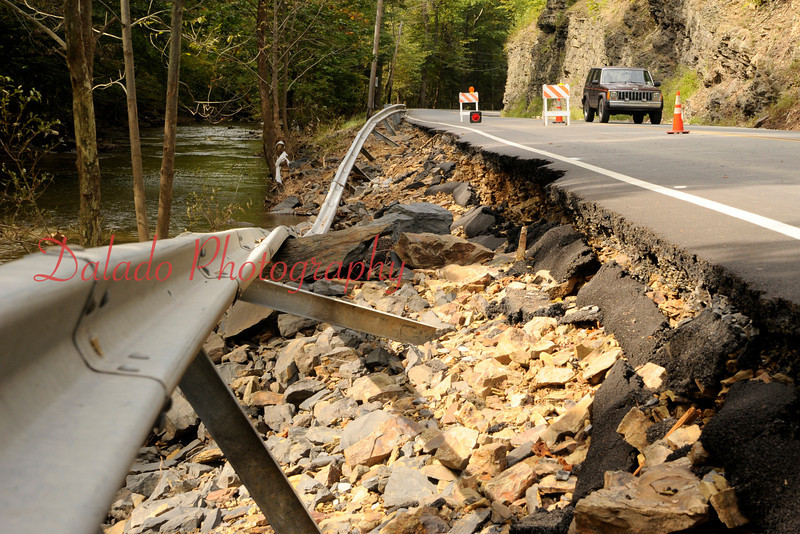 A vehicle travels by a closed section of state Route 487 near the Northumberland/Columbia County near Knoebels.