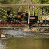 The Ole Smokey train passes over Roaring Creek on Friday, Sept. 16.