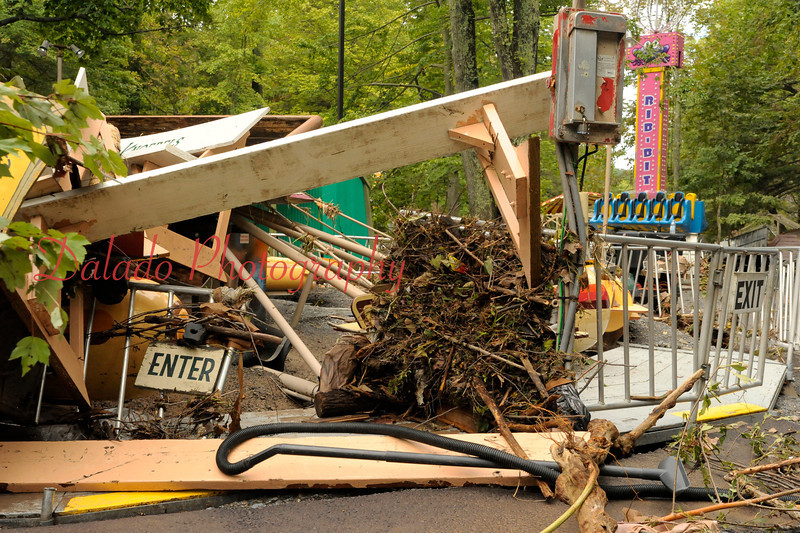 A pile of debris, including the Iwo Jimi monument, on the Sky Fighters, Because they moved the stage benches before the storm, there seemed to be less piles of debris compared to 2006.