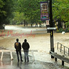 Jon Hower and his daughter, Brittany, of Elysburg, look at a swollen Roaring Creek from back entrance to Knoebels Amuesment Resort, on Sept. 07, around 3 p.m. This was around the second crest, but before the third.