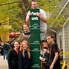 The McGrath family, of Chalfont, Bucks County, pose for a photograph at a flood level marker at Knoebels Amusement Resort on Saturday, Sept. 17.